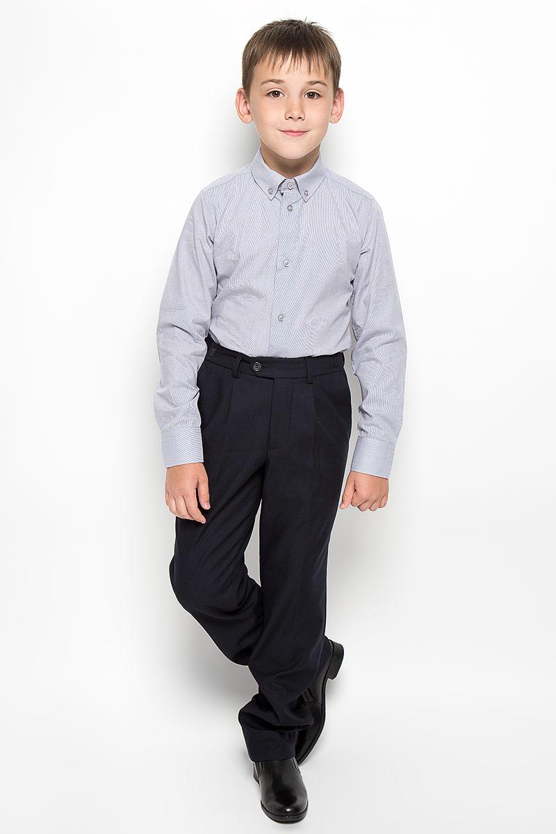 Рубашка для мальчика Orby School, цвет: светло-серый. 64187_OLB, вар.3. Размер 122, 7-8 лет64187_OLB, вар.3Стильная рубашка для мальчика Orby School с длинными рукавами идеально подойдет вашему ребенку. Изготовленная из полиэстера с добавлением хлопка, она мягкая и приятная на ощупь, не сковывает движения и позволяет коже дышать, не раздражает даже самую нежную и чувствительную кожу ребенка, обеспечивая ему наибольший комфорт. Рубашка классического кроя с отложным воротничком застегивается на пуговицы по всей длине. Рукава имеют широкие манжеты, также застегивающиеся на пуговицы. Низ изделия слегка закруглен.Оригинальный современный дизайн и модная расцветка делают эту рубашку стильным предметом детского гардероба. Ее можно носить как с джинсами, так и с классическими брюками.