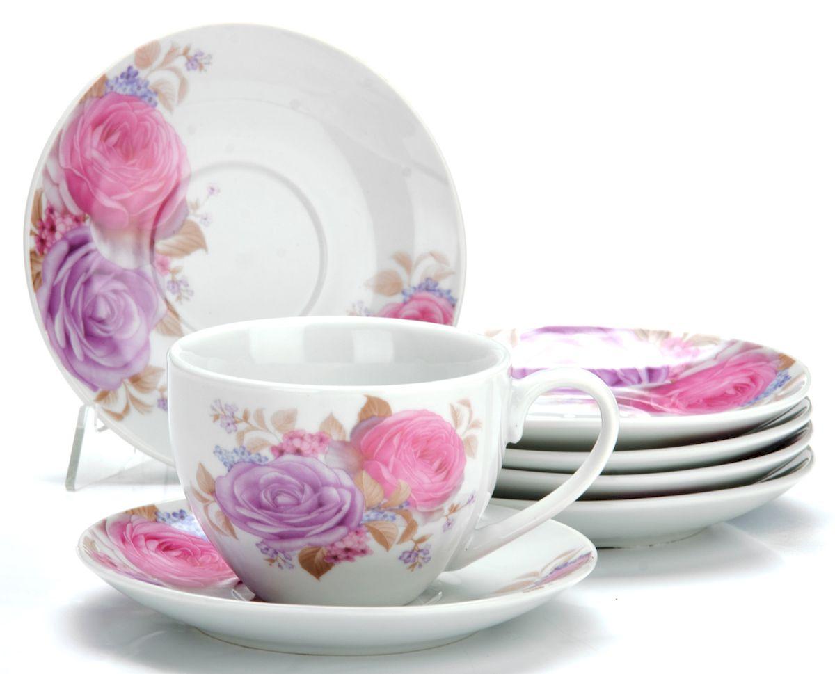 Набор чайный Loraine Цветы, 12 предметов25927Чайный набор Loraine Цветы состоит из шести чашек и шести блюдец, выполненных из высококачественного фарфора. Изделия оформлены ярким рисунком. Изящный набор эффектно украсит стол к чаепитию и порадует вас функциональностью и ярким дизайном. Набор упакован в красивую коробку и может послужить отличным подарком.Можно мыть в посудомоечной машине.Диаметр чашки (по верхнему краю): 9 см.Высота чашки: 6,5 см.Объем чашки: 220 мл. Диаметр блюдца: 13,5 см.Высота блюдца: 2 см.