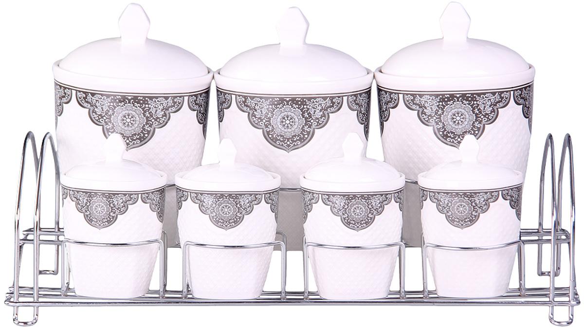 Набор банок Patricia, на подставке, 7 предметов, 800 мл, 200 мл. IM99-5202IM99-5202Набор банок на металлической подставке выполнены из высококачественного фарфора, включает в себя 7 банок различных размеров. Плотно закручивающая крышка на банке позволит хранить чай,кофе и многие другие сыпучие продукты. А дизайн таких банок украсит кухню любой хозяйки.