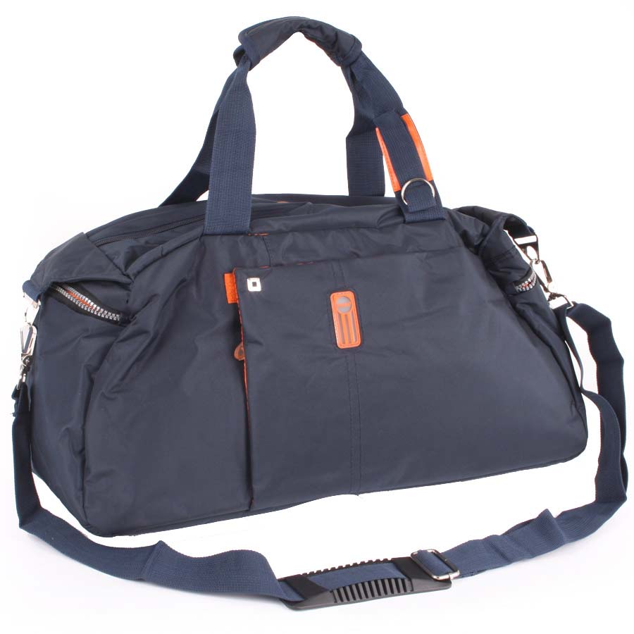 Сумка спортивная Polar, цвет: синий, 24,5 л. 1075410754Спортивная сумка Polar выполнена из нейлона. Основное отделение на застежке-молнии. Внутри расположен карман на молнии. У сумки имеются боковые карманы на молнии, кармашек на молнии спереди сумки. Изделие оснащено двумя удобными текстильными ручками и съемным текстильным плечевым ремнем.