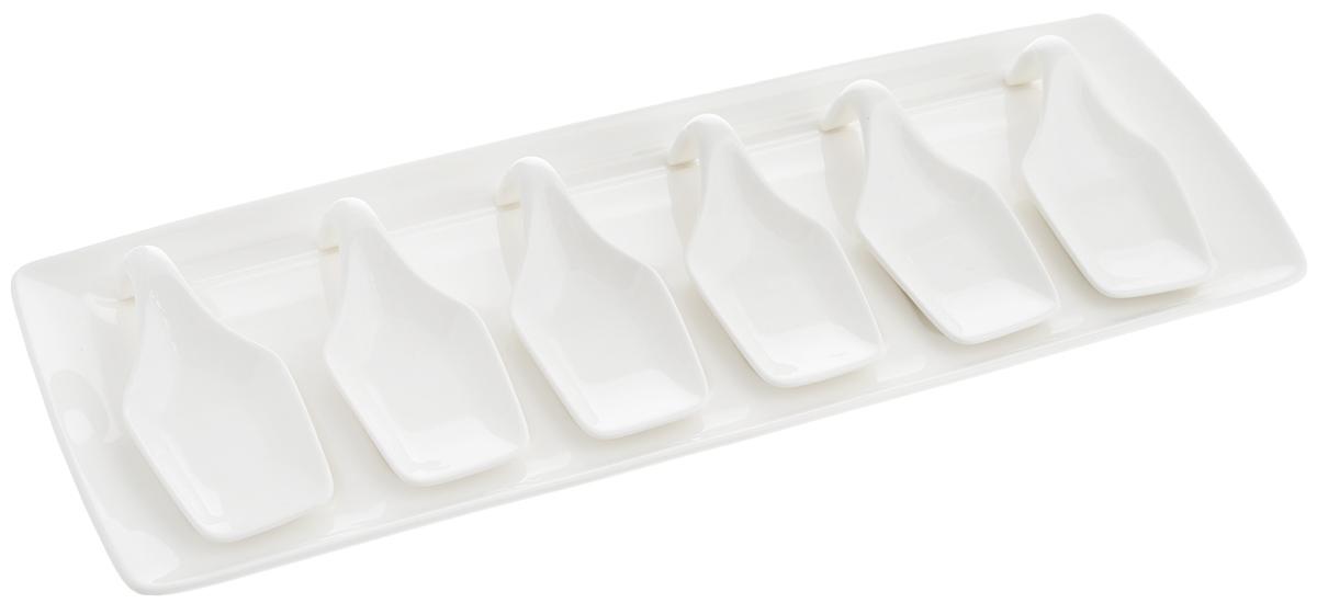 """Набор """"Deagourmet"""" состоит из 6 ложек специальной  формы, предназначенных для подачи и дегустации  закусок, снэков, паштетов, десертов. Также в комплект  входит поднос. Изделия выполнены из  высококачественного фарфора.  Подавать закуски на таких мисочках очень красиво - ваши  гости попробуют все вкусности, не испачкав пальцы.    Можно мыть в посудомоечной машине и использовать в  микроволновой печи. Размер подноса: 38 х 14 х 1,5 см.  Размер ложки: 11,5 х 5 х 3,3 см."""
