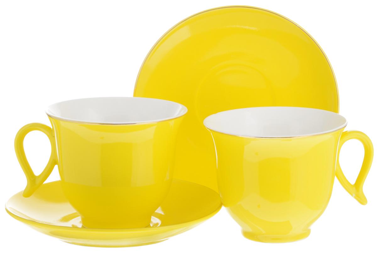 Набор чайный Loraine, цвет: желтый, белый, 4 предмета. 2474624746Набор Loraine выполнен из высококачественного фарфора. Изящный дизайн и красочность оформления придутся по вкусу и ценителям классики, и тем, кто предпочитает утонченность и изысканность. Чайный набор - идеальный и необходимый подарок для вашего дома и для ваших друзей в праздники, юбилеи и торжества! Он также станет отличным корпоративным подарком и украшением любой кухни. Чайный набор упакован в подарочную коробку из плотного цветного картона. Внутренняя часть коробки задрапирована белым атласом. Объем чашки: 220 мл. Диаметр чашки (по верхнему краю): 9,5 см. Высота чашки: 7,5 см.Диаметр блюдца: 14 см. Высота блюдца: 2,5 см.