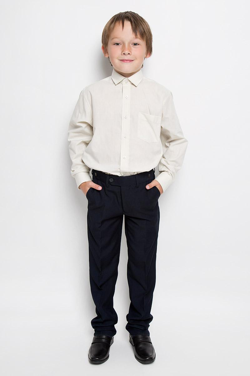 Рубашка для мальчика Tsarevich, цвет: бежевый. Cloud Cover X. Размер 32/134-140Cloud Cover XКлассическая рубашка для мальчика Tsarevich отлично сочетается как с джинсами, так и с брюками. Она выполнена из хлопка с добавлением полиэстера. Материал изделия легкий, мягкий и приятный на ощупь, не сковывает движения и позволяет коже дышать.Рубашка прямого кроя с длинными рукавами и отложным воротником застегивается на пуговицы по всей длине. Манжеты рукавов также имеют застежки-пуговицы. На груди расположен накладной карман. Такая рубашка займет достойное место в детском гардеробе!