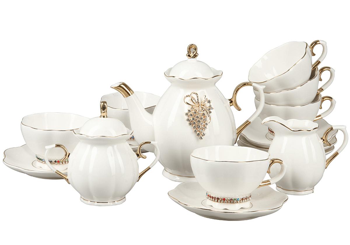 Чайный набор Rosenberg, 15 предметов. RCE-115002-1577.858@24556Чайный набор Rosenberg состоит из 6 чашек, 6 блюдец, заварочного чайника, молочника и сахарницы. Изделия выполнены из качественной глазурованной керамики, дополнены золотистой эмалью и стразами. Такой набор изысканно дополнит сервировку стола к чаепитию и станет отличным подарком к любому случаю. Объем чашек: 175 мл.Объем чайника: 1 л. Объем молочника: 250 мл. Объем сахарницы: 300 мл.