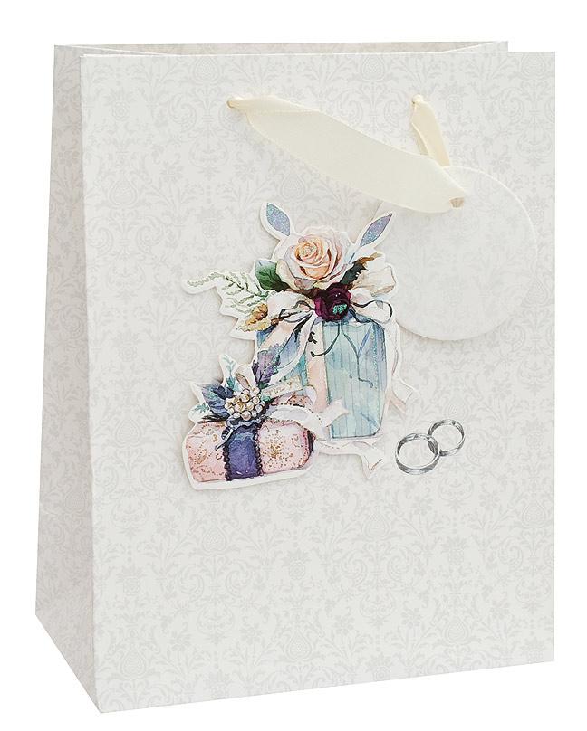 """Пакет подарочный """"Свадебный подарок"""" выполнен из качественной плотной бумаги с хорошей печатью, объемные элементы на пакете придают дополнительный яркий акцент."""