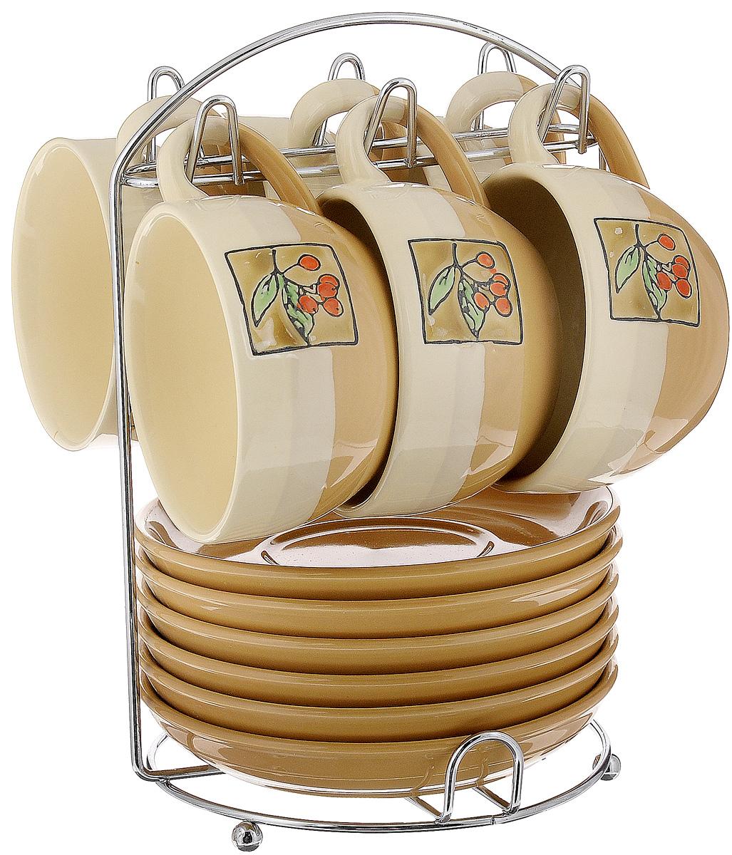 Набор чайный Calve. Ягоды, на подставке, 13 предметовCL-2022_бежевый, коричневый, оранжевыйНабор Calve. Ягоды состоит из шести чашек и шести блюдец, изготовленных из высококачественного фарфора. Чашки оформлены красочным рисунком. Изделия расположены на металлической подставке. Такой набор подходит для подачи чая или кофе.Изящный дизайн придется по вкусу и ценителям классики, и тем, кто предпочитает утонченность и изысканность. Он настроит на позитивный лад и подарит хорошее настроение с самого утра. Чайный набор Calve. Ягоды - идеальный и необходимый подарок для вашего дома и для ваших друзей в праздники.Можно мыть в посудомоечной машине. Объем чашки: 220 мл. Диаметр чашки (по верхнему краю): 9,5 см. Высота чашки: 6,3 см. Диаметр блюдца: 14,5 см. Высота блюдца: 2,3 см.Размер подставки: 16,5 х 16 х 22,5 см.