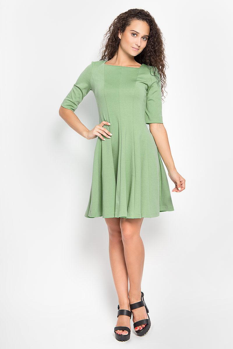 Платье Ruxara, цвет: зеленый. 105005_32. Размер 46105005_32Платье Ruxara, выполненное из высококачественного комбинированного материала, поможет создать отличный современный образ в стиле Casual.Модель приталенного силуэта с расклешенной юбкой дополнена вырезом горловины каре и рукавами длиной до локтя. Такое платье поможет создать яркий и привлекательный образ, в нем вам будет удобно и комфортно.