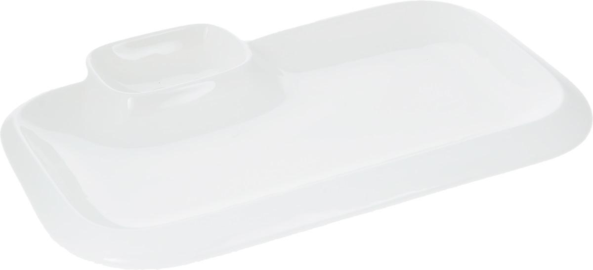 Блюдо Wilmax, 20 х 12 смWL-992573 / AОригинальное блюдо Wilmax, выполненное из высококачественного фарфора, имеет прямоугольную форму и оснащено соусником. Изделие идеально подойдет для сервировки праздничного или обеденного стола, а также станет отличным подарком к любому празднику.Размер блюда (по верхнему краю): 20 х 12 см.Высота стенки блюда: 2 см.Размер соусника (по верхнему краю): 7,2 х 5,5 см.Высота стенки соусника: 2,5 см. Ширина блюда (с учетом соусника): 17 см.