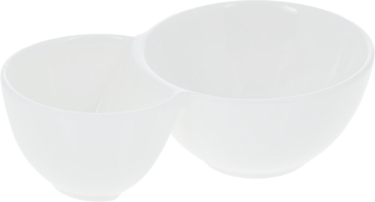 """Емкость для закусок """"Wilmax"""", изготовленная из высококачественного фарфора,  состоит из двух секций. Большая секция предназначена для закусок, а маленькая -  для соусов к ним. Такая емкость станет украшением как праздничного, так и  повседневного обеденного стола. Она функциональная, практичная в  использовании и легкая в уходе.   Диаметр секций: 9 см; 7 см. Общий размер емкости: 15 х 9 х 4,5 см."""