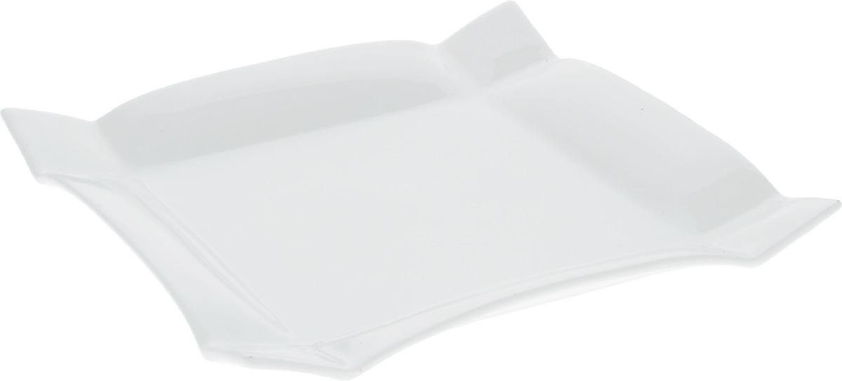 Тарелка Wilmax, 25 х 25 смWL-991232 / AТарелка Wilmax, изготовленная из высококачественного фарфора, имеет квадратную форму. Оригинальный дизайн придется по вкусу и ценителям классики, и тем, кто предпочитает утонченность и изысканность. Тарелка Wilmax идеально подойдет для сервировки стола и станет отличным подарком к любому празднику.Размер тарелки (по верхнему краю): 25 х 25 см.