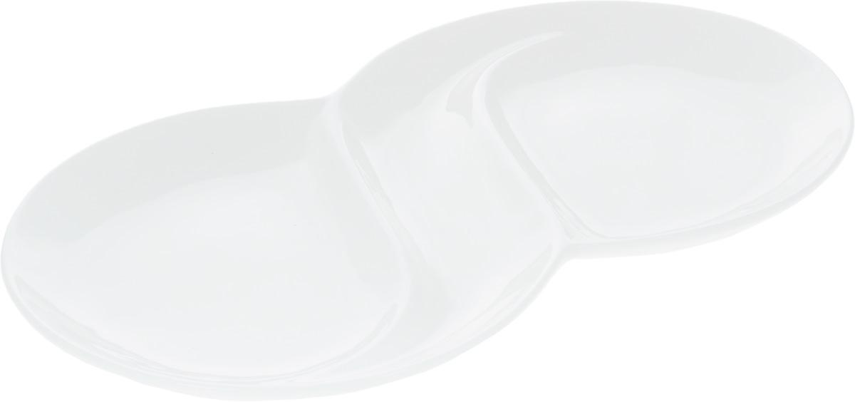 """Менажница """"Wilmax"""", изготовленная из высококачественного  фарфора, состоит из 2 секций, выполненных в виде блюд.  Изделие предназначено для подачи сразу нескольких видов  закусок, нарезок, соусов и варенья. Оригинальная менажница """"Wilmax"""" станет настоящим  украшением праздничного стола и подчеркнет ваш изысканный  вкус.  Размер менажницы: 31,8 х 18 х 2,5 см. Диаметр секций: 18 см."""