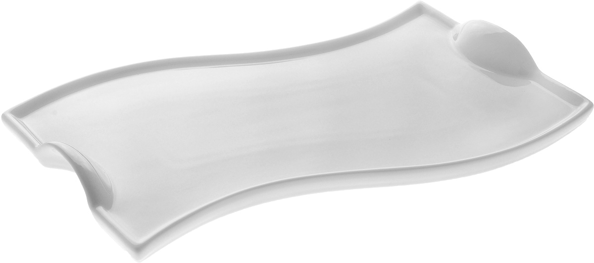 """Оригинальное блюдо """"Wilmax"""", изготовленное из фарфора с  глазурованным покрытием, оснащено  ручками для удобной переноски. Изделие прекрасно  подойдет для подачи нарезок, закусок и других  блюд. Оно украсит ваш кухонный стол, а также станет  замечательным подарком к любому празднику. Размер блюда: 26 х 15,5 см. Высота стенки: 1,5 см."""