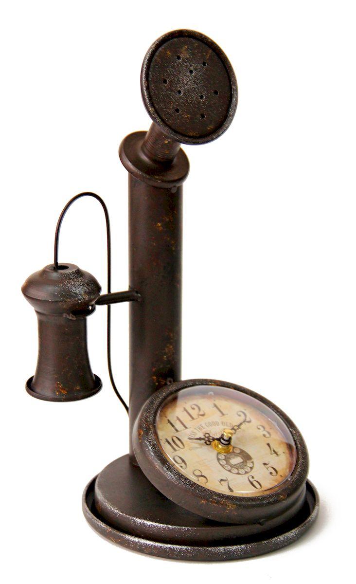 Часы настольные Magic Home Ретро Телефон, кварцевые, цвет: черный41491Настольные кварцевые часы Magic Home Ретро Телефон изготовлены из металла черного цвета,циферблат из черного металла с покрытием из принтованной бумаги. Настольные часы Magic Home Ретро Телефон прекрасно оформят интерьер дома или рабочий стол вофисе. Часы работают от одной батарейки типа АА мощностью 1,5V (не входит в комплект).