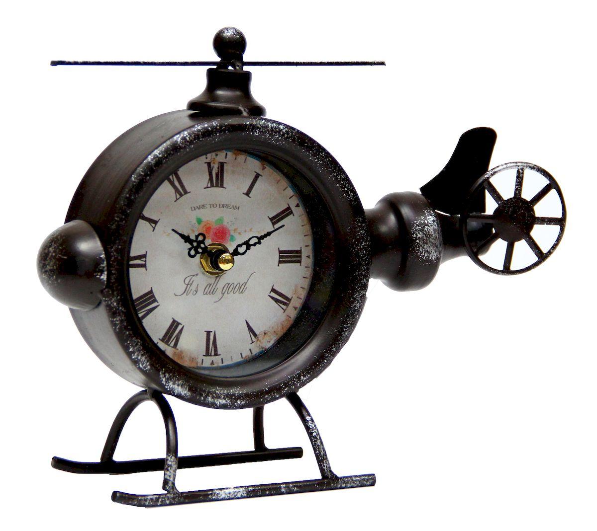 Часы настольные Magic Home Вертолет, кварцевые, цвет: черный41500Настольные кварцевые часы Magic Home Вертолет изготовлены из металла черного цвета, циферблат из черного металла с покрытием из принтованной бумаги. Настольные часы Magic Home Вертолет прекрасно оформят интерьер дома или рабочий стол в офисе.Часы работают от одной батарейки типа АА мощностью 1,5V (не входит в комплект).