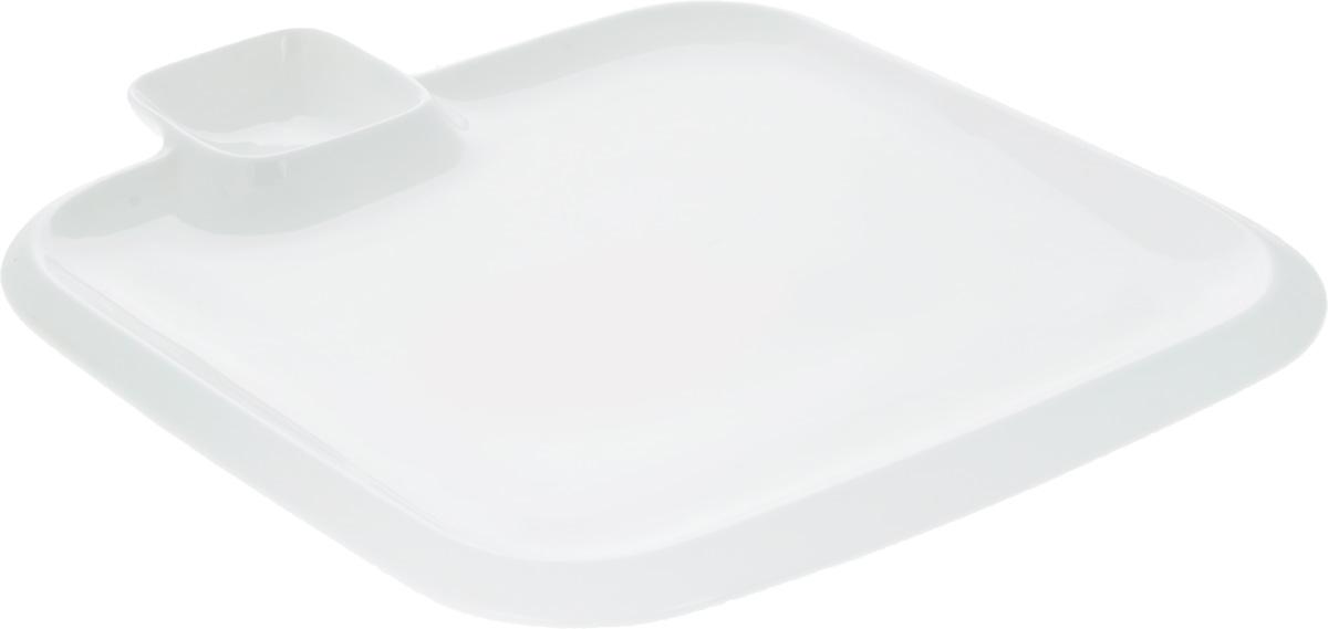 """Оригинальное блюдо """"Wilmax"""", выполненное из  высококачественного фарфора, имеет квадратную форму и  оснащено соусником.  Изделие идеально подойдет для сервировки праздничного или  обеденного стола, а также станет отличным подарком к любому  празднику. Размер блюда: 31 х 31 см. Размер соусника: 7,8 х 7,8 см."""