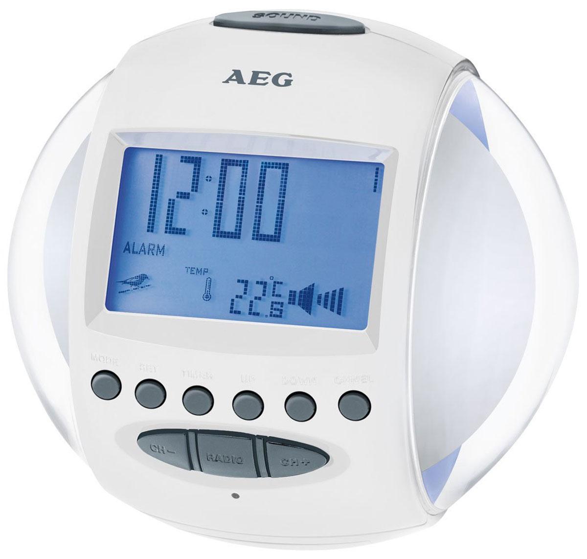 AEG MRC 4117, White радиочасыMRC 4117 weissFM –радиочасы AEG MRC 4117 со звуками природы и мелодиями, а также сменной подсветкой из 7 различных цветов, индикацией даты и температуры, настройкой громкости и таймером обратного отсчета непременно займут достойное место в интерьере вашего дома.FM-радиоприемник с 4 ячейками для запоминания радиостанций Дипольная антенна, цифровая индикация частоты 2 будильника (3 возможности включения 1, 2 или 1+2) Сигнал будильника: радио, звуки природы, мелодия в сочетании со сменной подсветкой 6 звуков природы и 5 мелодий по выбору, режим повтора сигнала будильника Спящий режим (5-60 минут)