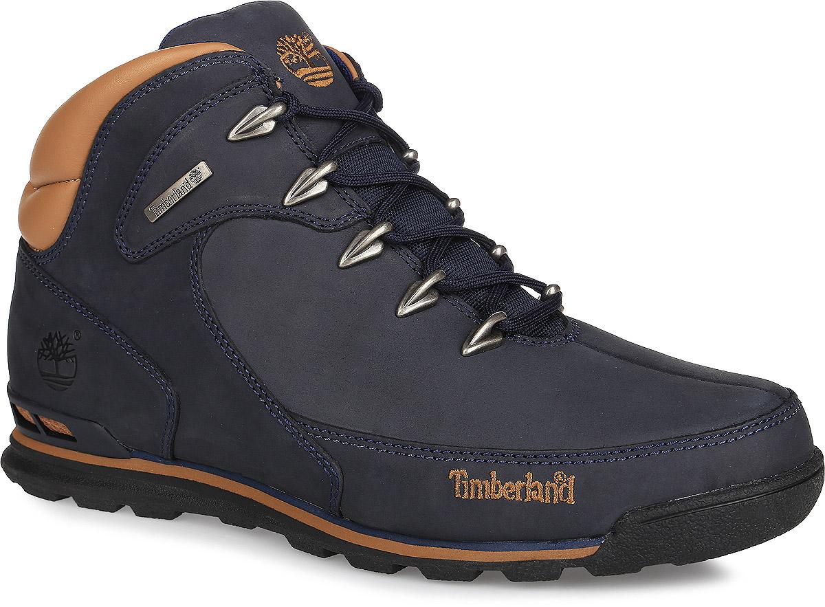 Ботинки мужские Timberland Euro Rock Hiker, цвет: темно-синий. TBL6165RM. Размер 8,5 (41)TBL6165RMСтильные мужские ботинки Euro Rock Hiker от Timberland заинтересуют вас своим дизайном с первого взгляда! Модель изготовлена из натуральной кожи и текстиля. Обувь оформлена сбоку фирменным тиснением, вышитым названием бренда и металлической пластиной с гравировкой бренда, на язычке - вышитым фирменным логотипом. Классическая шнуровка прочно зафиксирует обувь на вашей ноге. Подкладка из текстиля не натирает. Стелька Anti-Fatigue из материала ЭВА с текстильной поверхностью обеспечивает поддержку и отличную амортизацию, значительно снижается нагрузка на пятку и позвоночник. Подошва с рельефным протектором гарантирует отличное сцепление на любых поверхностях. Модные ботинки займут достойное место среди вашей коллекции обуви.