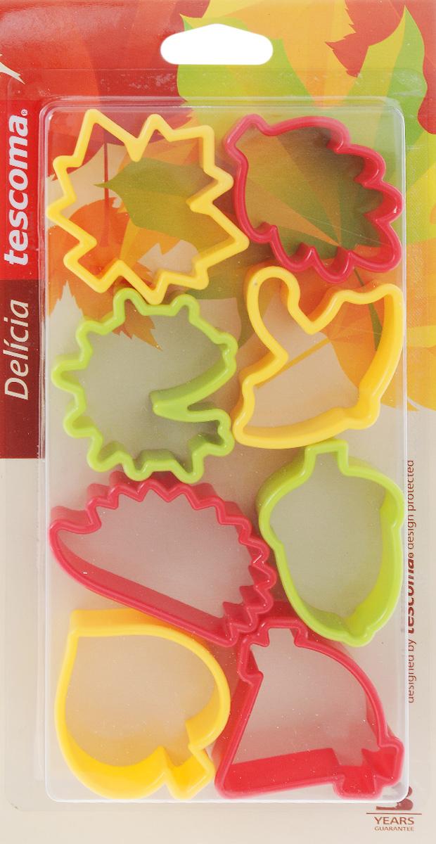 """Формочки для вырезания печенья Tescoma """"Delicia. Осень"""" изготовлены из высококачественного пластика. В набор входят 8 двухсторонних формочек, с помощью которых можно вырезать печенье в форме осенних листочков, желудей и т.д. Изделие прекрасно подходит для вырезания печенья разных размеров из песочного и пряничного теста. С помощью таких формочек вы без труда приготовите оригинальное печенье, которое наверняка порадует и удивит гостей. Можно использовать формочки как трафареты для поделок из соленого теста или пластилина. В комплект входит также пластиковое кольцо, на которое можно подвешивать формочки.    Можно мыть в посудомоечной машине. Средняя длина формочек: 6 см."""