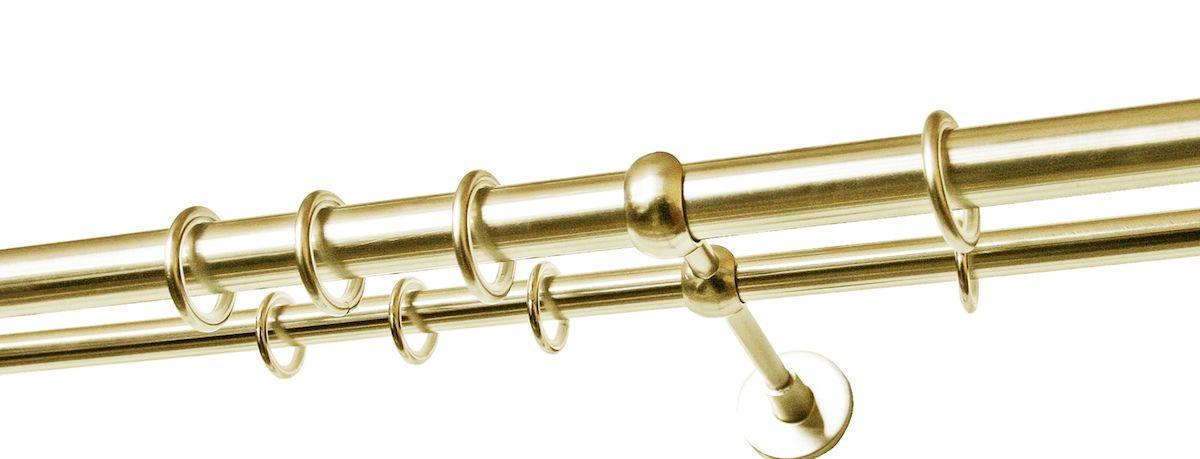 Карниз двухрядный Уют Ост, металлический, составной, цвет: латунь, диаметр 20 мм, длина 2,8 м22.02ТО.680К.280Двухрядный круглый карниз Уют Ост выполнен из цинко-алюминиевого сплава с гальваническим покрытием. Подходит для использования двух видов занавесей. Поверхность гладкая. Способ крепления: настенное. Возможно сочетание штанг различных диаметров и цветов. В комплект входят 4 штанги, 2 соединителя, 3 кронштейна с крепежом и 56 колец с крючками. Наконечникиприобретаются дополнительно.Такой карниз будет органично смотреться в любом интерьере.Диаметр карниза: 20 мм.
