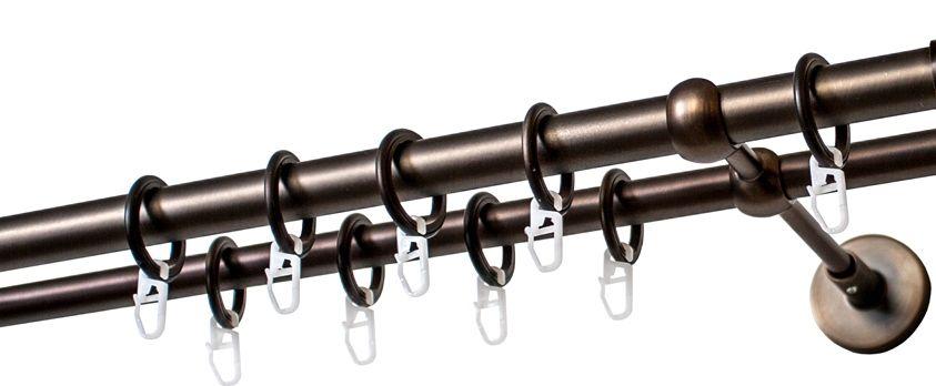 """Двухрядный круглый карниз Уют """"Ост"""" выполнен из цинко-алюминиевого сплава с гальваническим покрытием. Подходит для использования двух видов занавесей. Поверхность гладкая. Способ крепления настенное. Возможно сочетание штанг различных диаметров и цветов.   В комплект входят 4 штанги, 2 соединителя, 3 кронштейна с крепежом и 56 колец с крючками. Наконечники  приобретаются дополнительно.  Такой карниз будет органично смотреться в любом интерьере.  Диаметр карниза: 20 мм."""