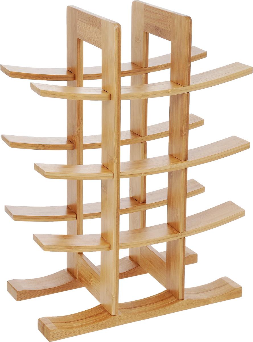 """Подставка для бутылок """"Zeller"""", изготовленная из бамбукового дерева, предназначена для размещения шести винных или пивных бутылок. Устойчивая форма, удобство, надежная конструкция делают эту подставку незаменимой для хранения бутылок. Данное изделие идеально впишется в интерьер любой кухни и будет служить элементом декора. Подставка поставляется в разобранном виде. Изделие состоит из 10 элементов, в комплект входят 4 самореза и инструкция по сборке.Размер подставки: 29 х 16 х 42 см. Количество отделений для бутылок: 6."""