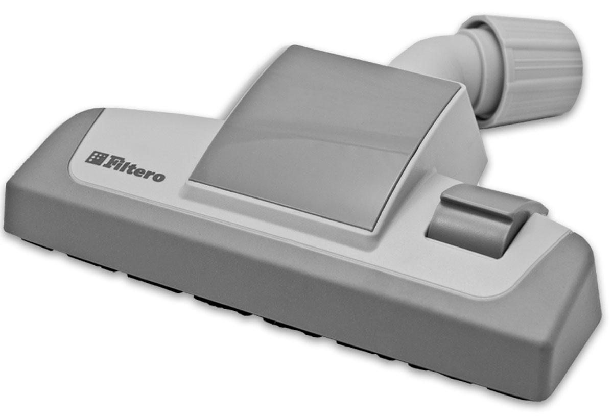 Filtero FTN 16 универсальная насадка для пылесосаFTN 16Комбинированная насадка Filtero FTN 16 пол-ковер с прорезиненным корпусом и колесиками, с шириной рабочей зоны 26 см. Оснащена универсальным зажимом, который обеспечивает возможность использования насадки с большинством пылесосов известных марок, с диаметром удлинительной трубки 30-37 мм. Насадка Filtero FTN 16 с удобным переключателем пол-ковер позволяет производить уборку любых напольных покрытий. Наличие колесиков предотвращает появление царапин на жестких полах и обеспечивает плавный ход на мягких покрытиях. Прорезиненный корпусзащищает ножки мебели от повреждений.Посадочный диаметр: от 30 до 37 мм