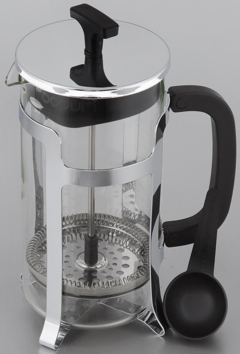 """Френч-пресс Bodum """"Jesper"""" позволит быстро и просто приготовить свежий и ароматный чай  или кофе. Корпус изготовлен из высококачественного жаропрочного стекла, устойчивого к  окрашиванию, царапинам и термошоку. Фильтр-поршень из нержавеющей стали выполнен по  технологии """"press-up"""" для обеспечения равномерной циркуляции воды.  Готовить напитки с помощью френч-пресса очень просто. С помощью мерной ложечки насыпьте  внутрь заварку и залейте кипятком. Остановить процесс заваривания легко. Для этого нужно  просто опустить поршень, и заварка уйдет вниз, оставляя вверху напиток, готовый к  употреблению.  Заварочный чайник с прессом - это совершенный чайник для ежедневного использования.  Практичный и стильный дизайн полностью соответствует последним модным тенденциям в  создании предметов кухонной утвари. Можно мыть в посудомоечной машине. Диаметр френч-пресса (по верхнему краю): 9,5 см.  Высота френч-пресса (с учетом крышки): 22 см.  Длина ложки: 10 см."""