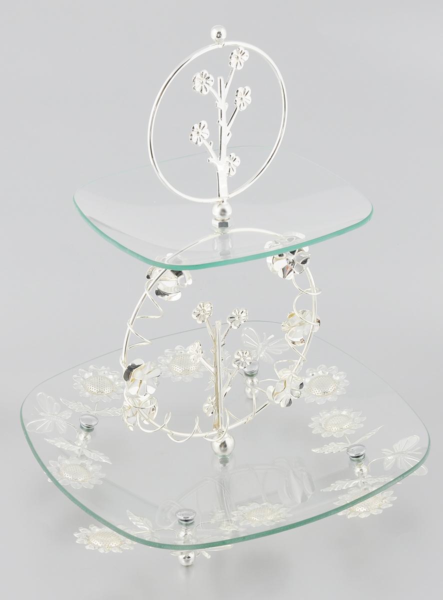 Ваза универсальная Marquis, 2-ярусная, высота 39 см7019-MRЭлегантная двухъярусная ваза Marquis, выполненная из стали с серебряно-никелевым покрытием, предназначена для красивой сервировки фруктов, конфет, пирожных. Изделие имеет 2 яруса. Блюда выполнены из стекла и декорированы металлическими вставками с изысканным орнаментом. Изделие поставляется в разобранном виде, легко собирается и разбирается. Ваза Marquis украсит сервировку вашего стола и подчеркнет прекрасный вкус хозяина, а также станет отличным подарком. Размер большого яруса: 30 х 30 см. Размер малого яруса: 20,5 х 20,5 см.Высота яруса: 2,5 см. Высота вазы (в собранном виде): 39 см.