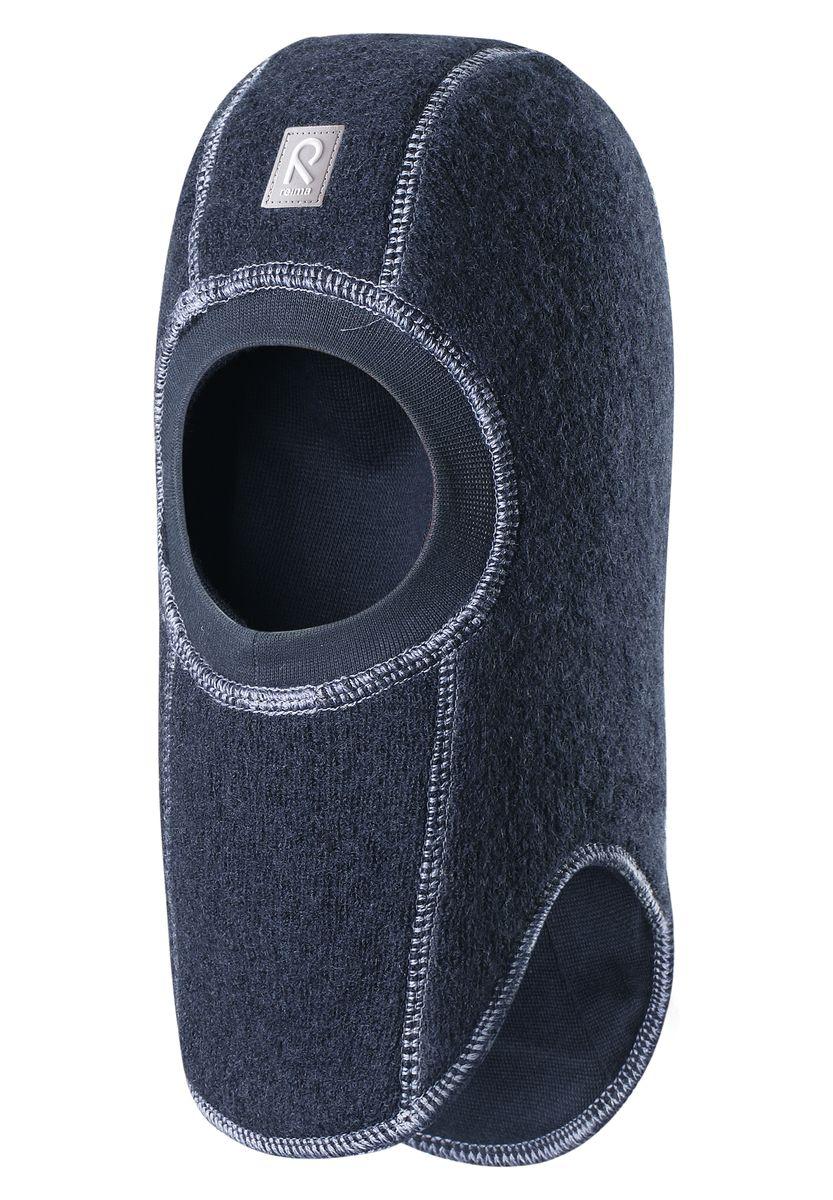 Балаклава детская Reima Repolainen, цвет: темно-синий. 518358-6980. Размер 46518358-6980Стильная и очень теплая шерстяная шапка-шлем для малышей на мягкой и плотной подкладке из смеси хлопка и эластана. Шерстяная поверхность с начесом ярко смотрится, а эластичный трикотаж облегчает надевание. Ветронепроницаемые вставки в области ушей защищают ушки от холодного ветра, а вязаная резинка вокруг лица плотно прилегает к коже и обеспечивает максимальный комфорт маленьким любителям прогулок на свежем воздухе.