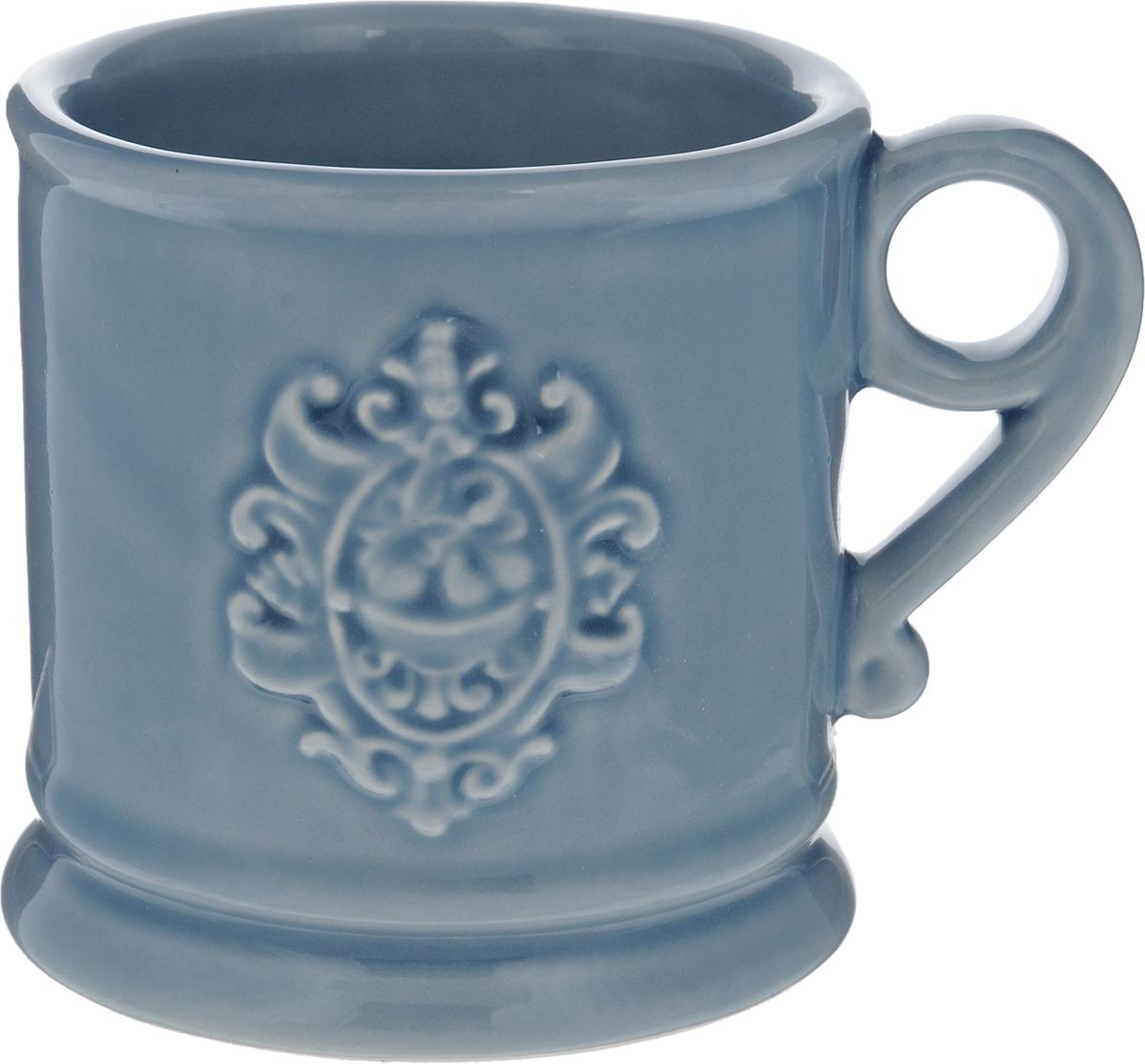Кружка Nuova Cer Аральдо, цвет: голубой, 400 млNC8307-CRZ-ALКружка Nuova Cer Аральдо выполнена из высококачественной толстой керамики с глазурованным покрытием и оформлена оригинальным рельефным рисунком. Красивая и удобная кружка дополнит интерьер вашей кухни.Не рекомендуется мыть в посудомоечной машине и использовать в микроволновой печи.Диаметр кружки (по верхнему краю): 10 см.