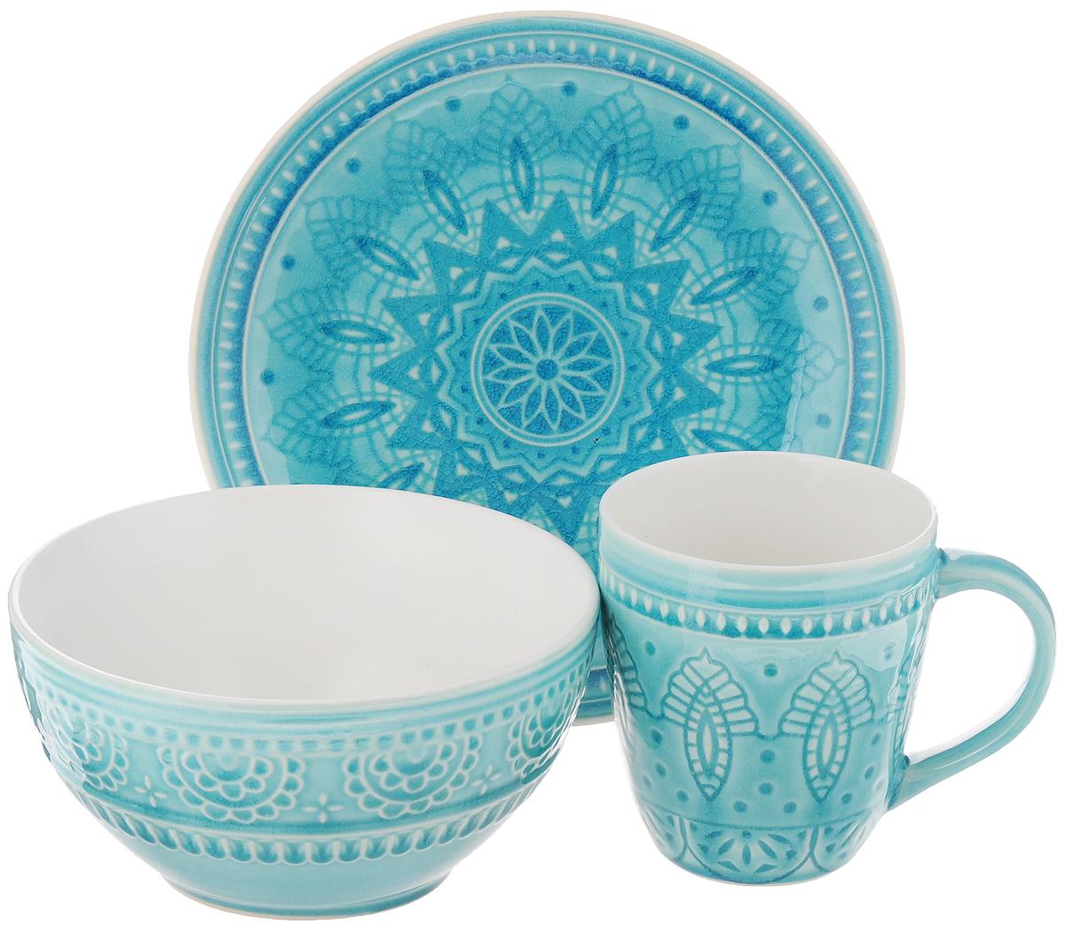Набор столовой посуды Tongo, цвет: голубой, 3 предметаS-03 b TongoНабор столовой посуды Tongo состоит из салатника, кружки, десертной тарелки. Изделия выполнены из экологически чистой каменной керамики, покрытой сверкающей глазурью. Посуда оформлена изысканным рельефным орнаментом. Поверхность слегка потрескавшаяся, что придает изделию оттенок старины. Такой набор посуды прекрасно подходит как для торжественных случаев, так и для повседневного использования. Стильный дизайн изящно украсит сервировку стола. Можно использовать в посудомоечной машине и микроволновой печи. Диаметр десертной тарелки: 20,5 см. Объем салатника: 800 мл. Диаметр салатника (по верхнему краю): 16 см. Высота салатника: 8 см. Объем кружки: 350 мл. Диаметр кружки (по верхнему краю): 9 см. Высота кружки: 10 см.