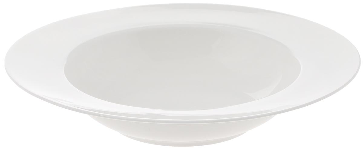 """Глубокая тарелка """"Wilmax"""", выполненная из  высококачественного фарфора, имеет классическую круглую форму и предназначена для  красивой  сервировки обеденного стола. Она  прекрасно впишется в интерьер вашей кухни и станет  достойным дополнением к кухонному инвентарю.  Тарелка """"Wilmax"""" подчеркнет прекрасный вкус хозяйки и станет  отличным подарком для вас и ваших близких. Можно мыть в посудомоечной машине и использовать в микроволновой печи.  Диаметр тарелки (по верхнему краю): 25 см. Объем: 600 мл."""
