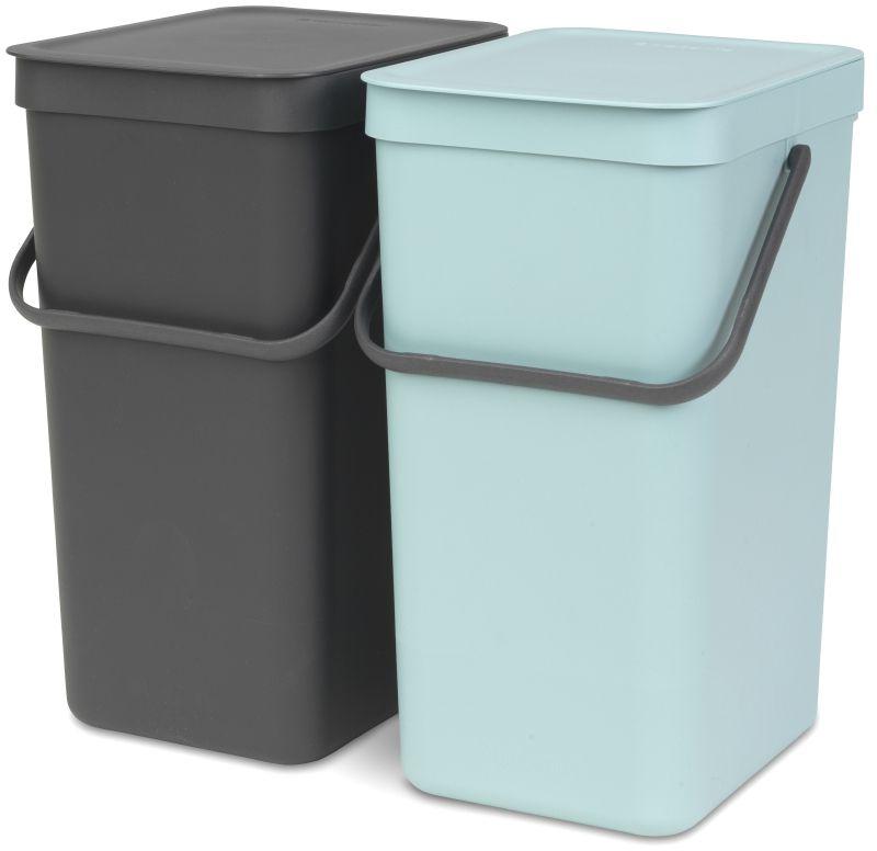 Ведро мусорное Brabantia Sort & Go, встраиваемое, цвет: мятный, серый, 16 л, 2 шт. 110023110023Компактное изделие, занимающее мало места – идеальное решение для раздельного сбора домашних отходов. Может устанавливаться на дверцы, открывающиеся вправо или влево. Простое в установке изделие – в комплект входит настенный держатель, крепежные детали и инструкция. Минимальные установочные размеры: 430 мм (В) x 550 мм (Ш) x 360 мм (Г). Полный доступ к мусорным ведрам – блок с ведрами выдвигается из шкафа при открывании дверцы. Прочная опорная конструкция – отсутствие нагрузки на петли дверцы. Прочные ручки и удобные захваты снизу для удобства освобождения от мусора. Отлично подходят для чистки овощей или фруктов, уборки и т.п. – крышка фиксируется в открытом положении. Имеются идеально подходящие по размеру мешки PerfectFit (размер D) – удобно устанавливаются в ведро.
