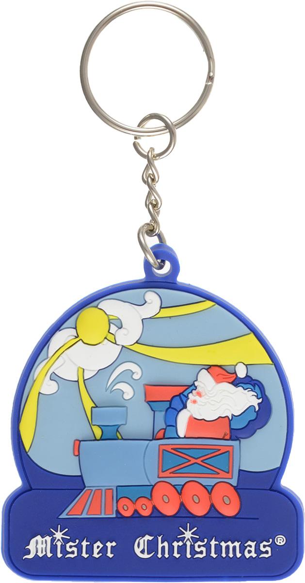 """Симпатичный брелок """"Дед Мороз на паровозе"""" послужит хорошим новогодним сувениром для ваших друзей и знакомых. С помощью металлического кольца брелок можно пристегнуть на пояс, к рюкзаку, сумке или повесить на связку ключей.    Откройте для себя удивительный мир сказок и грез. Почувствуйте волшебные минуты ожидания праздника, создайте новогоднее настроение вашим дорогим  и близким.                              Характеристики:  Материал:  каучук, металл.  Размер брелока (без учета кольца):  5,5 см x 6 см x 0,3 см.  Производитель: Ирландия.  Артикул:  PVC-15.  Mister Christmas как марка, стоявшая у самых истоков новогодней индустрии в России, сегодня является подлинным лидером рынка. Продукция марки обрела популярность и заслужила доверие самого широкого круга потребителей.  Миссия Mister Christmas - это одновременно и возрождение утраченных рождественских традиций, и привнесение модных тенденций в празднование Нового года и Рождества, развитие новогодней культуры в целом.  Благодаря таланту и мастерству дизайнеров, технологиям и опыту мировой новогодней индустрии товары от Mister Christmas стали настоящим символом Нового года, эталоном качества и хорошего вкуса."""