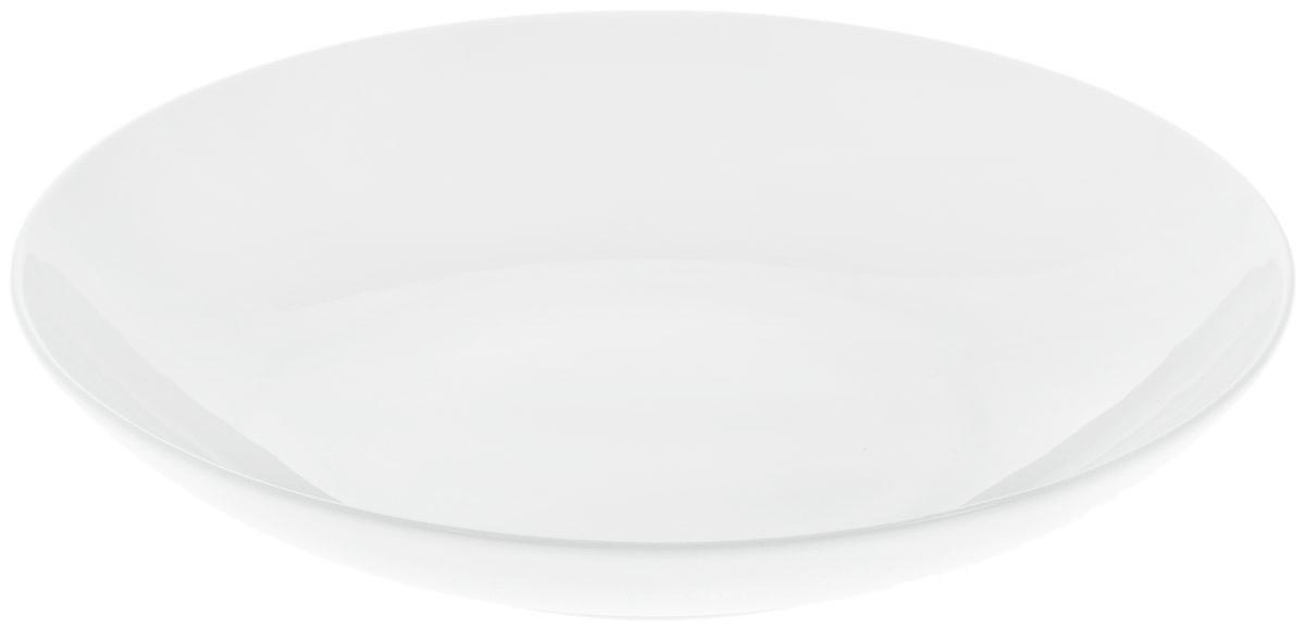 Блюдо Wilmax, диаметр 30,5 см. WL-991119 / AWL-991119 / AБлюдо Wilmax изготовлено из высококачественного фарфора с глазурованным покрытием. Материал легкий, тонкий, свет без труда проникает сквозь изделие. Посуда имеет роскошную белизну, гладкость и блеск достигаются за счет особой рецептуры глазури. Изделие обладает низкой водопоглощаемостью, высокой термостойкостью и ударопрочностью, а также экологичностью. Посуда долговечна и рассчитана на постоянное интенсивное использование. Гладкая непористая поверхность исключает проникновение бактерий, изделие не будет впитывать посторонние запахи и сохранит первоначальный цвет. Блюдо углубленное, оно имеет круглую форму и не имеет полей, прекрасно подойдет для подачи различных закусок, сладостей, салатов, фруктов и ягод. Такое блюдо украсит ваш праздничный или обеденный стол, а оригинальный дизайн придется по вкусу и ценителям классики, и тем, кто предпочитает утонченность и изысканность.Можно мыть в посудомоечной машине и использовать в микроволновой печи.