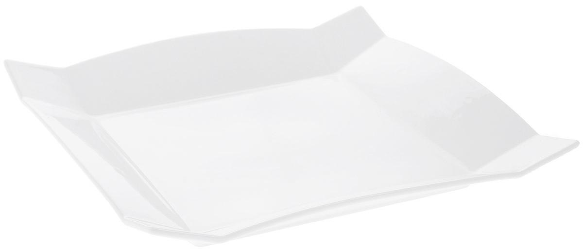 """Блюдо """"Wilmax"""" изготовлено из высококачественного фарфора с глазурованным  покрытием. Материал легкий, тонкий, свет без труда проникает сквозь изделие.  Посуда имеет роскошную белизну, гладкость и блеск достигаются за счет особой  рецептуры глазури.  Изделие обладает низкой водопоглощаемостью, высокой термостойкостью и  ударопрочностью, а также экологичностью. Посуда долговечна и рассчитана на  постоянное интенсивное использование. Гладкая непористая поверхность  исключает проникновение бактерий, изделие не будет впитывать посторонние  запахи и сохранит первоначальный цвет.  Блюдо имеет квадратную форму со слегка приподнятыми краями, оно прекрасно  подойдет для подачи различных закусок, нарезок, сладостей.  Такое блюдо украсит ваш праздничный или обеденный стол, а оригинальный  дизайн придется по вкусу и ценителям классики, и тем, кто предпочитает  утонченность и изысканность. Можно мыть в посудомоечной машине и использовать в микроволновой печи."""