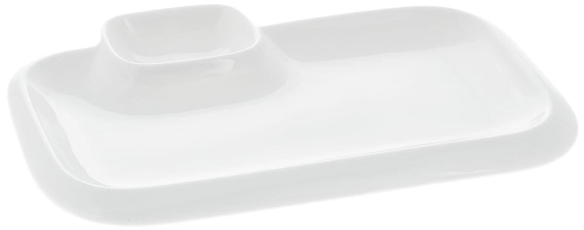 Блюдо Wilmax, прямоугольное, с соусником, 25,5 х 15 смWL-992574 / AБлюдо Wilmax прямоугольной формы изготовлено из высококачественного фарфора с глазурованным покрытием. Материал легкий, тонкий, свет без труда проникает сквозь изделие. Посуда имеет роскошную белизну, гладкость и блеск достигаются за счет особой рецептуры глазури. Изделие обладает низкой водопоглощаемостью, высокой термостойкостью и ударопрочностью, а также экологичностью. Посуда долговечна и рассчитана на постоянное интенсивное использование. Гладкая непористая поверхность исключает проникновение бактерий, изделие не будет впитывать посторонние запахи и сохранит первоначальный цвет. Такое блюдо прекрасно подойдет для подачи различных блюд, например, закусок, нарезок, сладостей. Для соуса предусмотрен специальный соусник. Такое блюдо украсит ваш праздничный или обеденный стол, а оригинальный дизайн придется по вкусу и ценителям классики, и тем, кто предпочитает утонченность и изысканность.Можно мыть в посудомоечной машине и использовать в микроволновой печи.