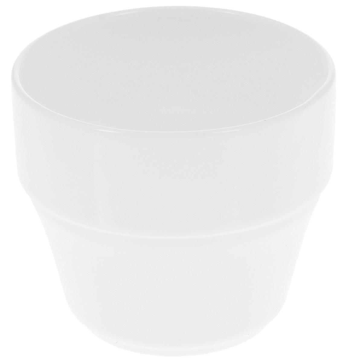 """Кружка """"Wilmax"""" изготовлена из высококачественного фарфора, покрытого глазурью. Материал легкий, тонкий, свет без труда проникает сквозь изделие. Посуда имеет роскошную белизну, гладкость и блеск достигаются за счет особой рецептуры глазури.  Изделие обладает низкой водопоглощаемостью, высокой термостойкостью и ударопрочностью, а также экологичностью. Посуда долговечна и рассчитана на постоянное интенсивное использование. Гладкая непористая поверхность исключает проникновение бактерий, изделие не будет впитывать посторонние запахи и сохранит первоначальный цвет.  Кружка штабелируемая, то есть несколько кружек легко вставляются друг в друга, что экономит место при хранении. Такая кружка пригодится в любом хозяйстве, она функциональная, практичная и легкая в уходе.  Можно мыть в посудомоечной машине и использовать в микроволновой печи.  Диаметр (по верхнему краю): 7,5 см.  Высота стенки: 7 см."""