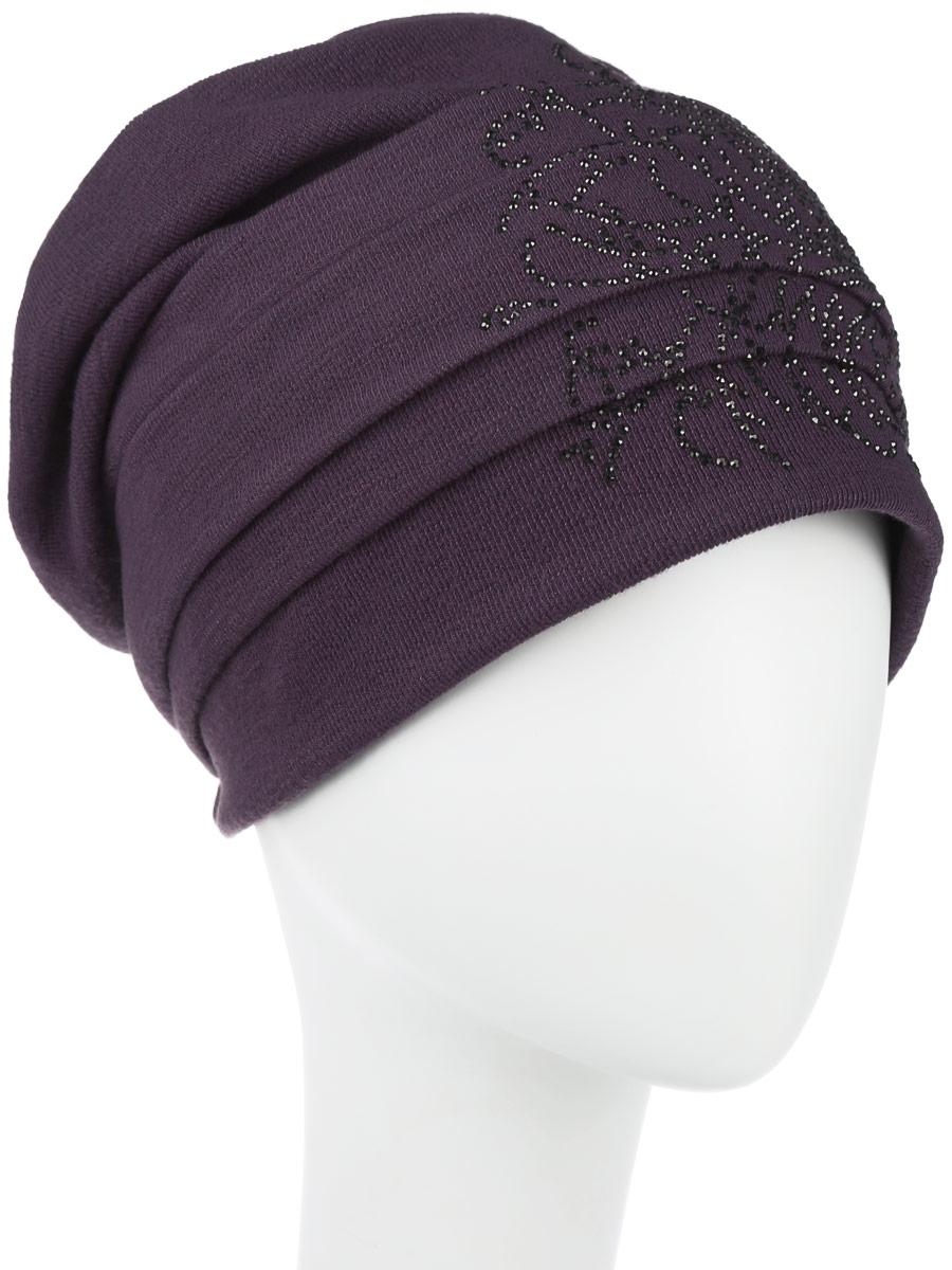 Шапка женская Level Pro, цвет: темно-сиреневый. 994319. Размер универсальный994319Стильная женская шапка Level Pro дополнит ваш наряд и не позволит вам замерзнуть в холодное время года. Шапка наполовину выполнена из шерсти с добавлением полиэстера , что позволяет ей великолепно сохранять тепло и обеспечивает высокую эластичность и удобство посадки. Внутренняя сторона модели флисовая. Изделие оформлено оригинальными тканевыми прострочками спереди и сзади. Дополнено цветочной выкладкой из блестящих страз. Такая шапка составит идеальный комплект с модной верхней одеждой, в ней вам будет уютно и тепло.