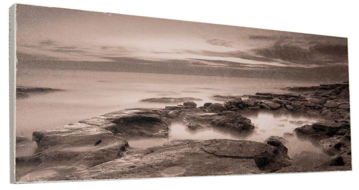 Картина Mister Poster Каменистый мрачный берег, 60 х 24 см0343-24-60Картина Mister Poster - это высококачественная репродукция на деревянной раме. Лицевая поверхность имитирует штукатурку или натуральный холст, края окрашены вручную специальным декоративным составом.Современные технологии, уникальное оборудование и оригинальные чернила, используемые при изготовлении, делают постер устойчивым к выцветанию, а также гарантируют стойкость к воздействию негативных внешних факторов. Интерьер дома и офиса, в котором находится человек, в значительной степени влияет на его настроение и работоспособность. Правильное оформление интерьера создает благоприятный психологический климат, улучшает настроение и мотивирует. Добавьте «красок» в ваш интерьер и, возможно, в вашу жизнь.