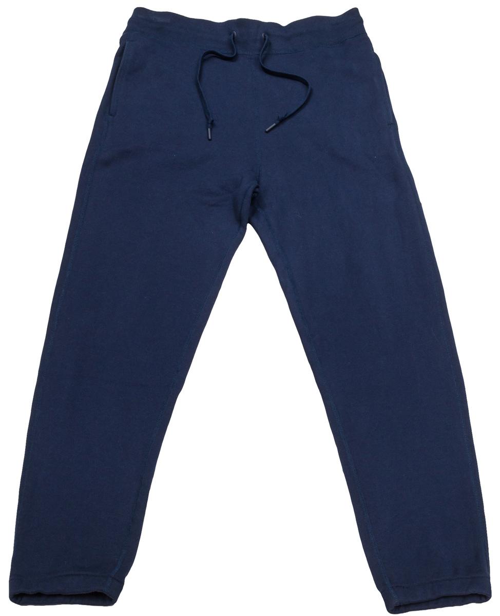 Брюки спортивные мужские Converse Sportswear Jogger, цвет: темно-синий. 10000657467. Размер L (50)10000657467Удобные мужские спортивные брюки Converse, выполненные из натурального хлопка, великолепно подойдут для отдыха, повседневной носки, а также для занятий спортом. Модель прямого кроя и средней посадки имеет широкую эластичную резинку на поясе, объем талии регулируется при помощи шнурка-кулиски. Спереди изделие имеет два втачных кармана, сзади один накладной.