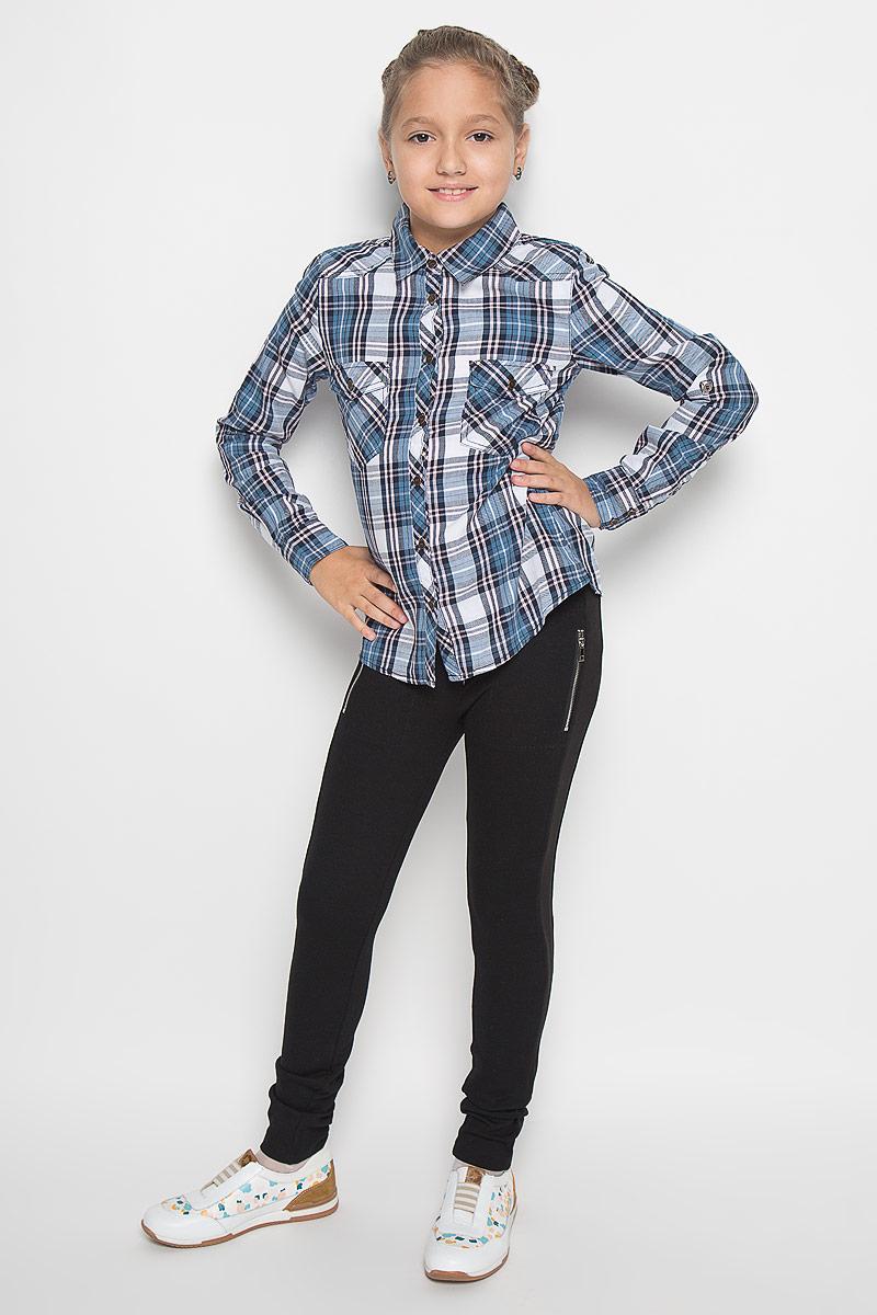 Рубашка для девочки Sela, цвет: голубой, белый, светло-розовый. B-612/840-6414. Размер 116, 6 летB-612/840-6414Рубашка для девочки Sela, выполненная из натурального хлопка, идеально подойдет для повседневной носки. Материал изделия очень мягкий, приятный на ощупь, не стесняет движений и позволяет коже дышать.Рубашка с отложным воротником и длинными рукавами застегивается на пуговицы по всей длине. На манжетах предусмотрены застежки-пуговицы. Длину рукавов можно изменить при помощи хлястиков с пуговицами. На груди расположены накладные карманы, которые закрываются с помощью клапанов с пуговицами. Рубашка оформлена принтом в клетку.Такая рубашка поможет создать стильный образ, а также подарит ребенку комфорт в течение всего дня!