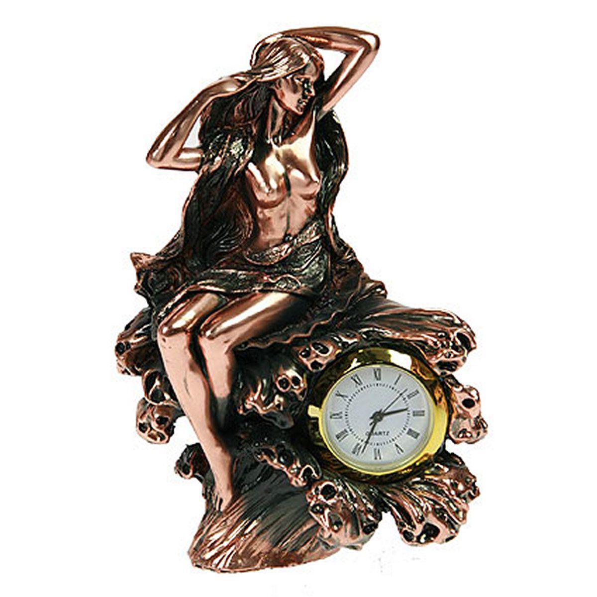 Часы настольные Русские Подарки Девушка. 127566127566Настольные кварцевые часы Русские Подарки Девушка изготовлены из полистоуна. Часы имеют три стрелки - часовую, минутную и секундную.Изящные часы красиво и оригинально оформят интерьер дома или рабочий стол в офисе. Также часы могут стать уникальным, полезным подарком для родственников, коллег, знакомых и близких.Часы работают от батареек типа АА (в комплект не входят).