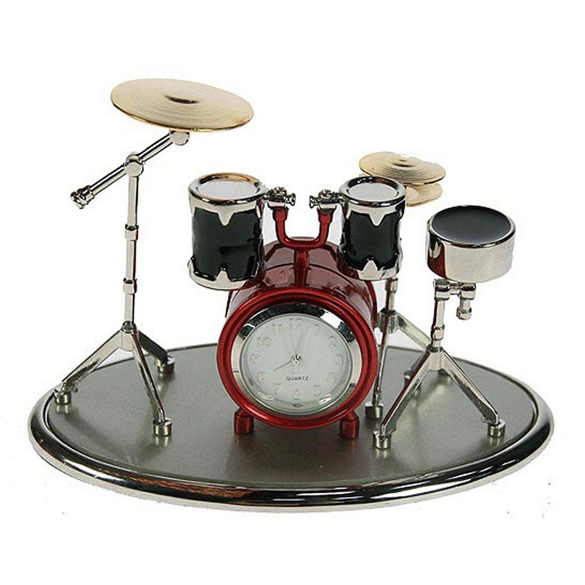 """Настольные кварцевые часы Русские Подарки """"Музыкальная группа"""" изготовлены из металла. Корпус оригинально оформлен в виде ударной установки. Часы имеют три стрелки - часовую, минутную и секундную.       Такие часы украсят интерьер дома или рабочий стол в офисе. Также часы могут стать уникальным, полезным подарком для родственников, коллег, знакомых и близких.   Часы работают от батареек типа SR626 (в комплект не входят)."""