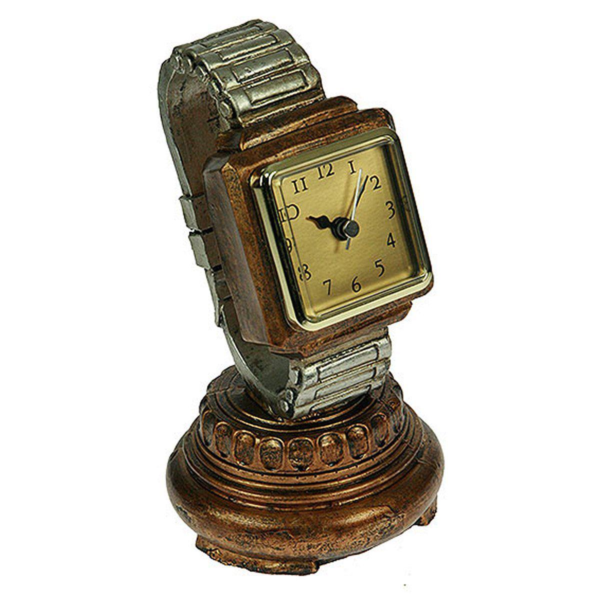 Часы настольные Русские Подарки, 20 х 10 см. 2851328513Настольные кварцевые часы Русские Подарки изготовлены из полистоуна,циферблат защищен стеклом. Часы имеют три стрелки - часовую, минутную и секундную.Такие часы красиво и необычно оформят интерьер дома или рабочий стол в офисе. Также часы могут стать уникальным, полезным подарком для родственников, коллег, знакомых и близких.Часы работают от батареек типа АА (в комплект не входят).