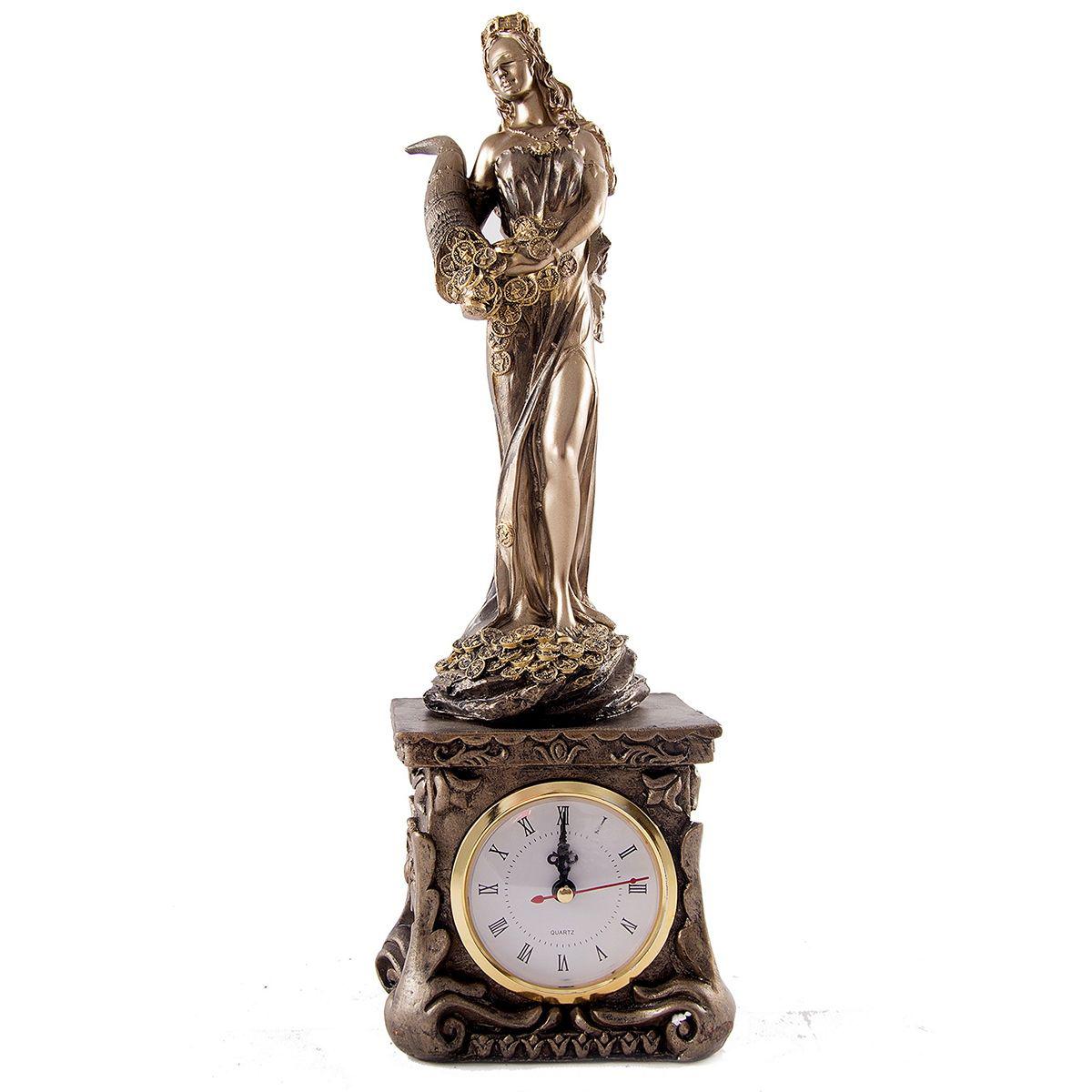 Часы настольные Русские Подарки Римская богиня счастья и удачи - Фортуна. 5934559345Настольные часы Русские подарки Римская богиня счастья и удачи - очень оригинальные и стильные настольные часы. Корпус выполнен из полистоуна. Они прекрасно впишутся практически в любой интерьер и станут превосходным украшением вашей комнаты. Это красивый и практичный подарок на любое торжество для родных и близких.