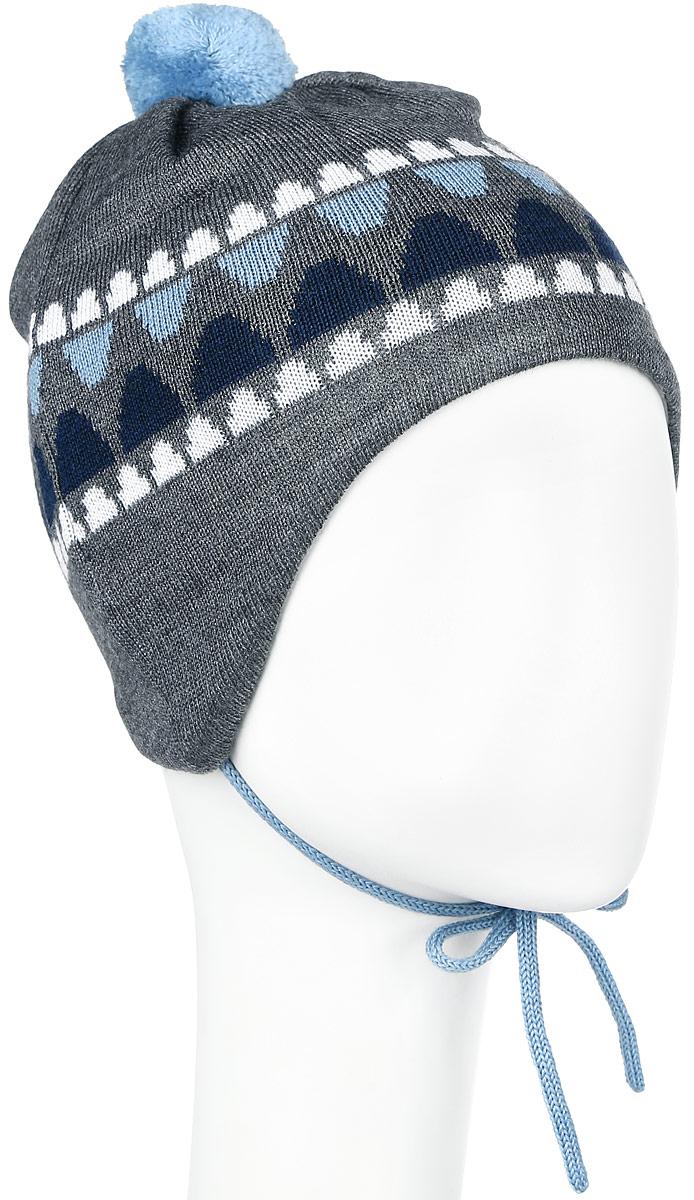 Шапка детская Reima Unonen, цвет: серый, голубой. 518378-6770. Размер 44518378_6770Очаровательная шапка Reima Unonen идеально подойдет для прогулок. Изготовленная из шерсти и акрила, она обладает хорошими дышащими свойствами и хорошо удерживает тепло. Шапка на макушке декорированапомпоном, а также дополнена завязками. Ветронепроницаемые вставки в области ушей защищают от холодного ветра, а мягкая подкладка из флиса приятна чувствительной детской коже. Сбоку модель дополнена нашивкой с логотипом бренда. Такая шапка станет модным и стильным предметом детского гардероба. Она улучшит настроение даже в хмурые холодные дни! Уважаемые клиенты!Размер, доступный для заказа, является обхватом головы ребенка.