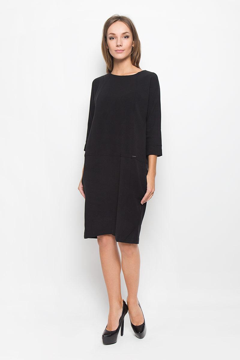 Платье Baon, цвет: черный. B431. Размер L (48)B431_BlackЭлегантное платье Baon выполнено из высококачественного эластичного полиэстера с добавлением вискозы. Такое платье обеспечит вам комфорт и удобство при носке и непременно вызовет восхищение у окружающих. Платье превосходно тянется, обладает высокой износостойкостью и отлично сидит по фигуре. Модель средней длины с цельнокроеными рукавами 3/4 и круглым вырезом горловины выгодно подчеркнет все достоинства вашей фигуры. Платье застегивается на застежку-молнию на спинке. По бокам расположены два открытых втачных кармана. Изысканное платье-миди создаст обворожительный и неповторимый образ.Это модное и комфортное платье станет превосходным дополнением к вашему гардеробу, оно подарит вам удобство и поможет подчеркнуть ваш вкус и неповторимый стиль.