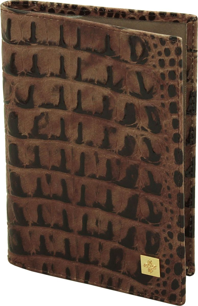 Обложка для паспорта женская Dimanche Loricata Brun, цвет: коричневый. 450/8450/8_коричневыйОбложка для паспорта Dimanche, выполненная из натуральной кожи, оформлена тиснением под рептилию и металлической пластинкой слоготипом бренда. Внутри расположено два кармана для фиксации документа. Обложка для паспорта сохранит внешний вид вашего документа изащитит от повреждений.