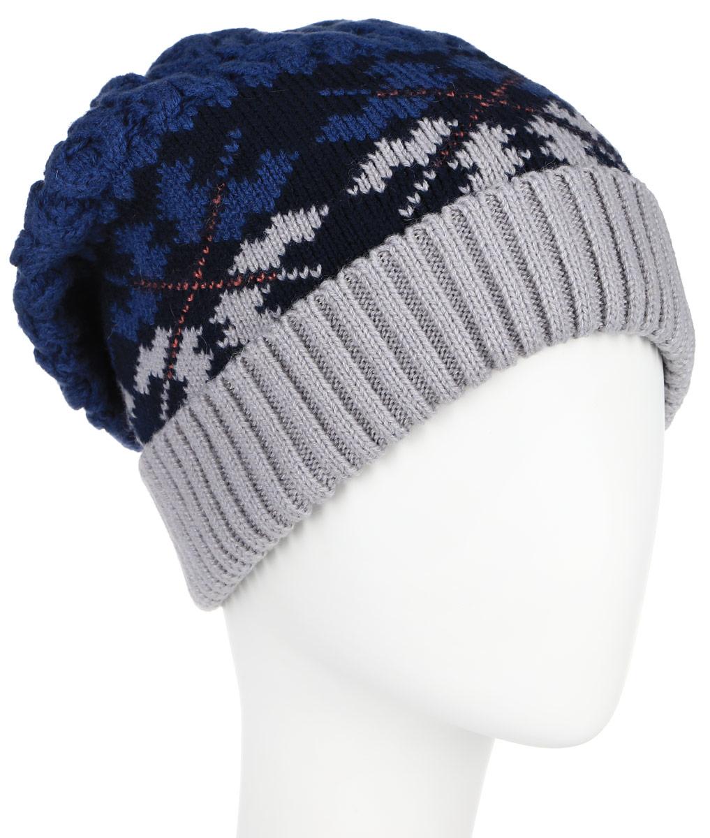 Шапка женская Finn Flare, цвет: темно-синий, серый. A16-12131_211. Размер 56A16-12131_211Вязаная женская шапка Finn Flare отлично подойдет для модниц в холодное время года. Изготовленная из шерсти с добавлением акрила, она мягкая и приятная на ощупь, обладает хорошими дышащими свойствами и максимально удерживает тепло. Шапочка плотно облегает голову, что обеспечивает надежную защиту от ветра и мороза.Модель шапки оформлена крупным вязаным узором. Макушка шапки фиксирована на затылке. Дополнено изделие небольшой металлической пластиной с названием бренда.Такая шапка не только теплый головной убор, но и стильный аксессуар. Она подчеркнет ваш образ и индивидуальность!Уважаемые клиенты!Размер, доступный для заказа, является обхватом головы.